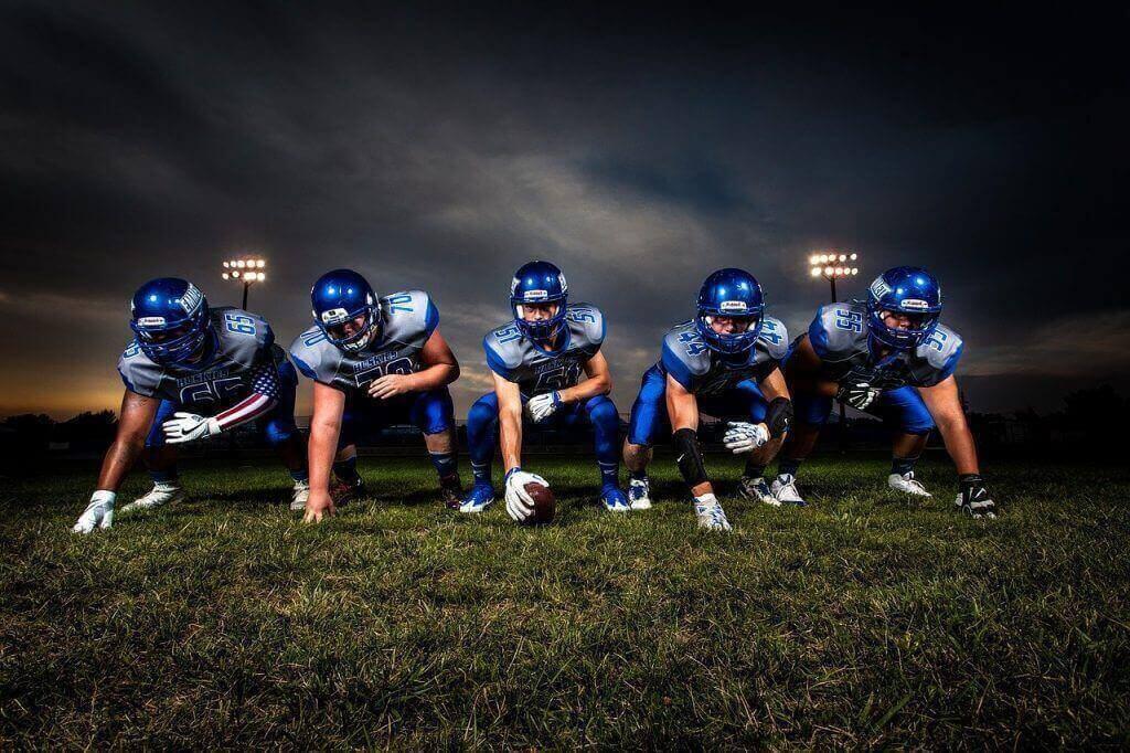 football players kneeling